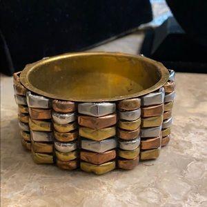 Silver copper and gold tone brass bangle